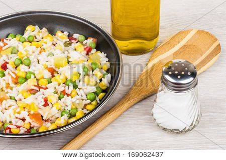 Frying Pan With Vegetable Mix, Bamboo Spoon, Vegetable Oil