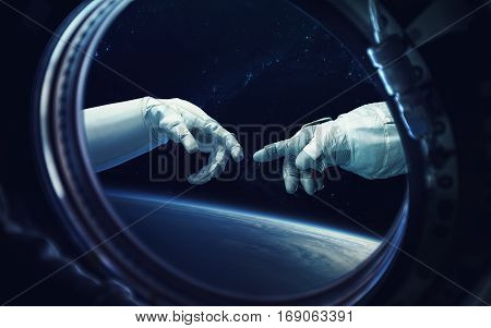 Michelangelo God's touch. Close up of human hands touching with fingers in space. Elements of this image furnished by NASA