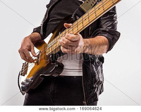 Bassist Plays Bass Guitar.