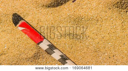 Spend roman candle laying in the sand on a beach