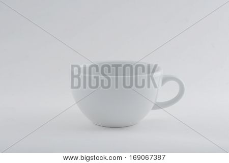 empty white cup whit clipping path isolated on white background.