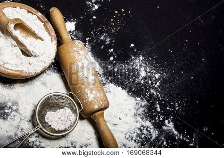 Metal Strainer, Rolling Pin And Bowl With Spilling Flour