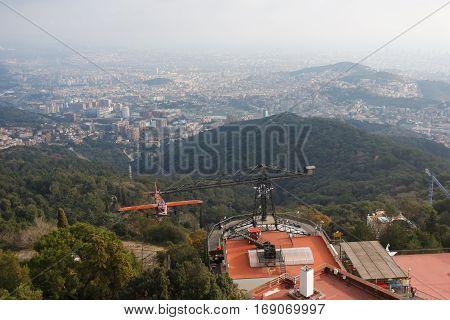 Barcelona Spain - January 03 2017: The plane-carousel in an amusement park on the Tibidabo hill in Barcelona