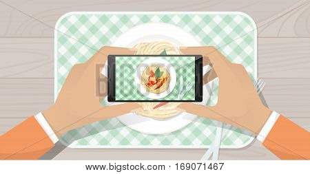 Man taking a picture of his lunch and sharing it online using a touch screen smartphone