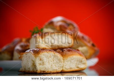sweet rolls with raisins on the red table