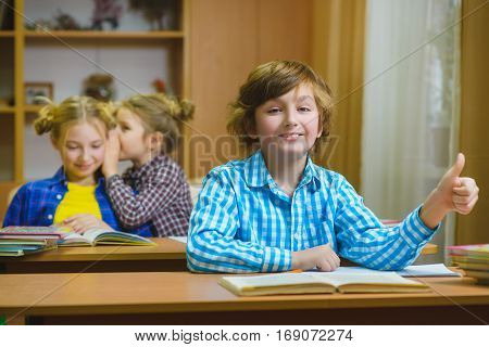 Children learning and doing homework in school classroom.