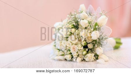 The bride's bouquet white roses tulips delicate flowers use as background or texture soft pastel colors.