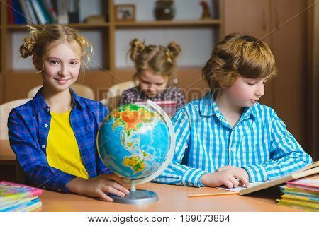 children on the geography lesson in school classroom. Educational concept.