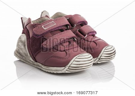 Little baby shoes on a white background