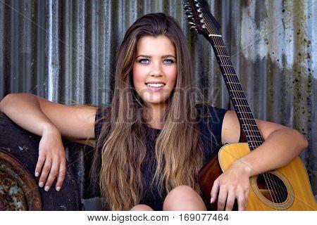Beautiful happy guitar musician woman