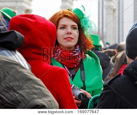 Moscow Russia - March 19 2016: Participant at the St. Patrick's Day Parade in the Irish hat in the park Sokolniki in Moscow