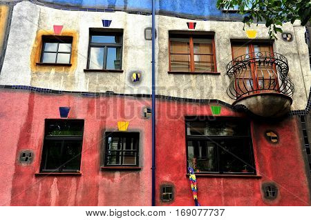 VIENNA AUSTRIA - JUNE 6: Windows of Hundertwasser house in Vienna on June 6 2016. Vienna is the capital and largest city of Austria.