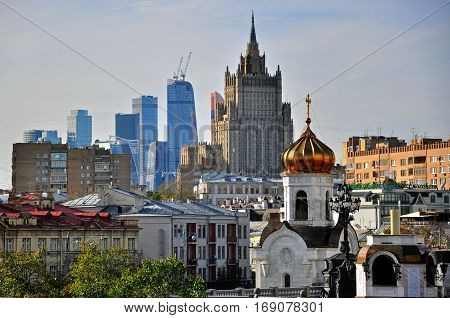 MOSCOW RUSSIA - OCTOBER 4: View of a church and skyscrapers of Moscow city on October 4 2015. Moscow is the capital and largest city of Russia.