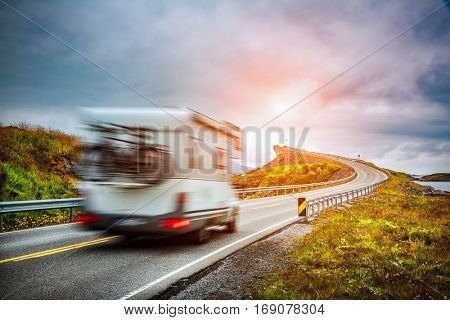 Caravan car travels on the highway. Caravan Car in motion blur. Norway. Atlantic Ocean Road or the Atlantic Road (Atlanterhavsveien) been awarded the title as