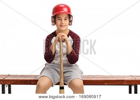 Boy with a helmet and a baseball bat sitting on a bench isolated on white background