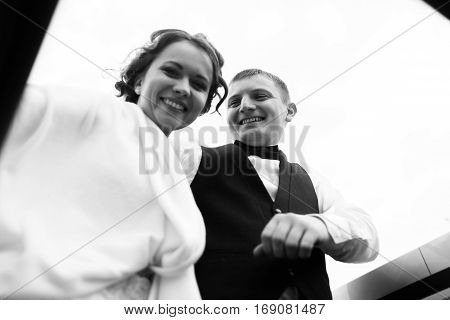 A View From Below On Smiling Newlyweds