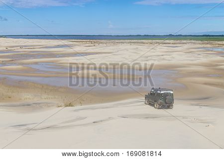 4X4 Car At Dunes In The Lagoa Do Peixe Lake