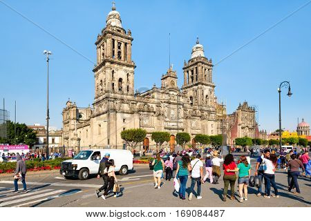 MEXICO CITY,MEXICO - DECEMBER 23,2016 : Locals and tourists next to the Mexico City Metropolitan Cathedral