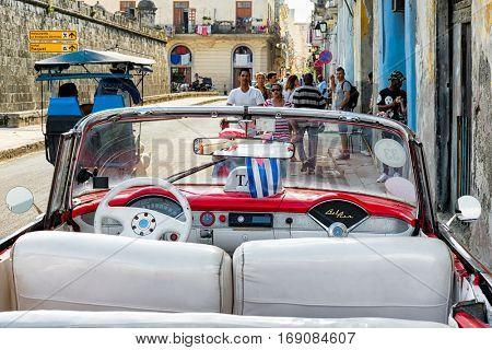 HAVANA,CUBA - JANUARY 7,2017 : Beautiful vintage convertible car on a street in Old Havana
