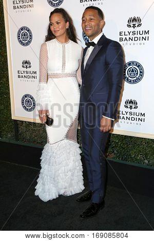 LOS ANGELES - JAN 7:  Chrissy Teigen, John Legend at the Art of Elysium 10th Annual Black Tie Heaven Gala at Red Studios on January 7, 2017 in Los Angeles, CA