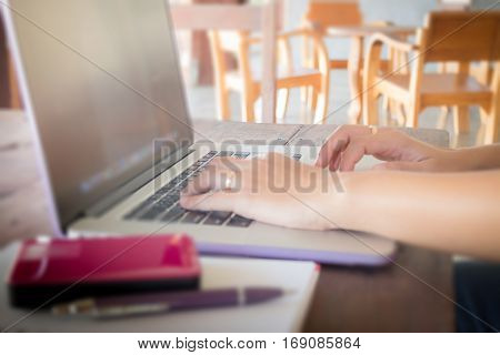 Mobile items on wooden work table stock photo