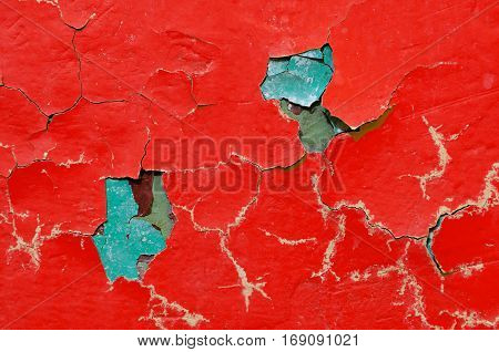 Texture background of red and green peeling paint on the texture surface. Texture of peeling paint. Old stone texture background surface.Rough peeling paint texture background. Stone background of peeling paint texture