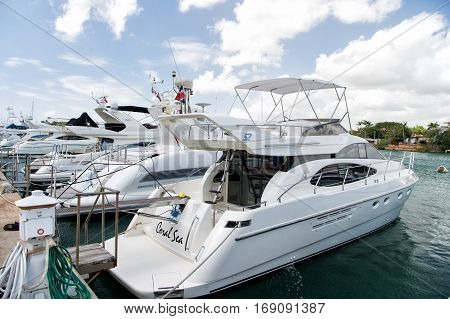 La Romana Dominican republic-February 16 2016: luxury yachts docked in the port in bay at sunny day with clouds on blue sky in La Romana Dominican Republic