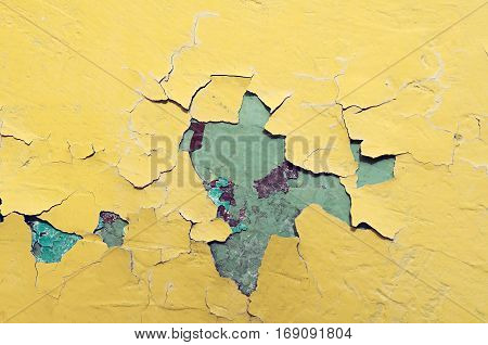 Texture background of light yellow and blue texture peeling paint on the old rough texture surface. Texture of peeling paint. Old stone texture background surface. Rough peeling paint texture background. Stone background of peeling paint texture