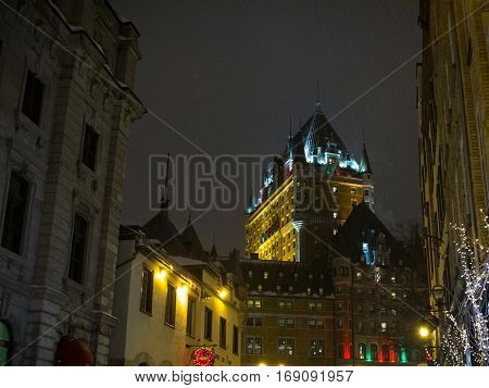 View of Frontenac Castle in winter under snow at night
