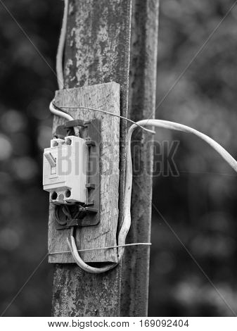 BLACK AND WHITE PHOTO OF SWITCH INSTALLED AT OUTSIDE