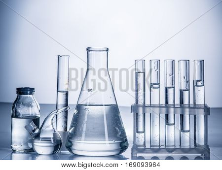 Different laboratory beakers and glassware. Monochrome.