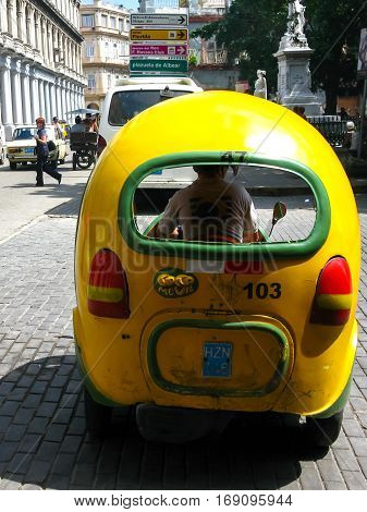 Coco-taxi waits for customers on a sunny day in Havana, Cuba, on June 4, 2009.