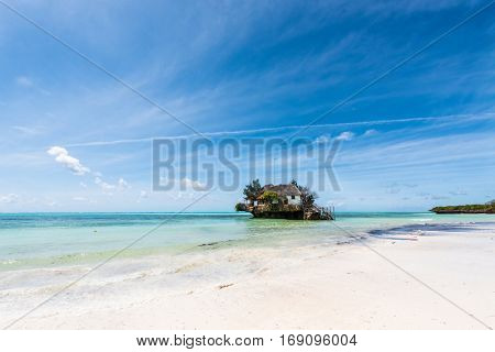 picturesque view of the Rock restaurant in ocean from a seashore in Zanzibar