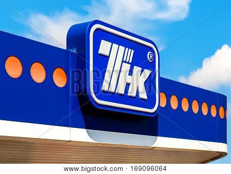 MOSCOW RUSSIA - JUNE 26 2016: The emblem of the oil company TNK against the blue sky. TNK is one of the largest russian oil companies