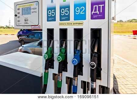 ST.PETERSBURG RUSSIA - JULY 31 2016: Filling the column with different fuels at the gas station Lukoil. Lukoil is one of the russian oil companies