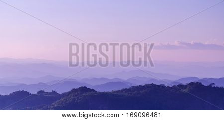 Sunrise sky and misty layer mountain in the morning at sri nan national park thailand toned and color filter