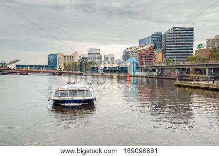 Melbourne Australia - December 27 2016: People traveling on Melbourne River Cruises boat along the Yarra river Victoria