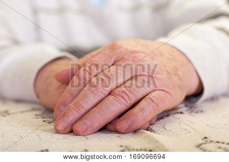 Close up picture of elderly man's hands
