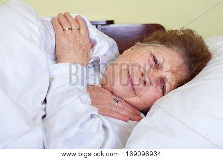 Picture of a sick old lady being bedridden