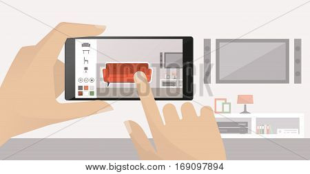 Man using a smartphone to place virtual furnishing in his room augmented reality and apps concept