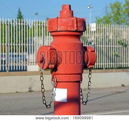 Water flowing from an open red fire hydrant. Closeup side view