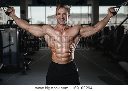 Brutal Strong Bodybuilder Man Pumping Up Muscles And Train Gym