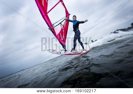 freestyle windsurfer doing tricks looking at the camera