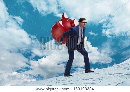 Businessman carrying the piggybank with savings