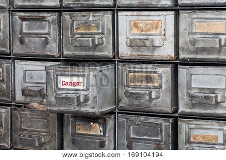 Danger information concept image. Opened box archive storage, filing cabinet interior. metal boxes with index cards. library service information management.