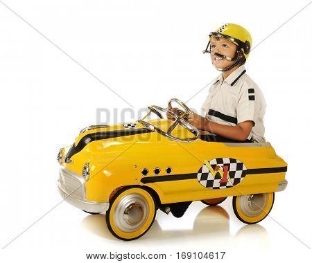 An adorable preschooler in a helmet and pedal