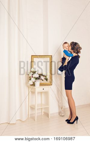 Mother and her child, embracing with tenderness and care, child giving mother flowers. Mother day concept, happiness and love.