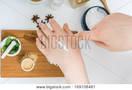 Young Woman Is Applying Homemade Cosmetics On Her Skin.