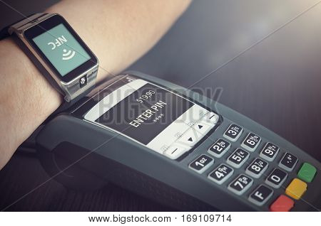 Man Making Payment Through Smartwatch Via Nfc Technology