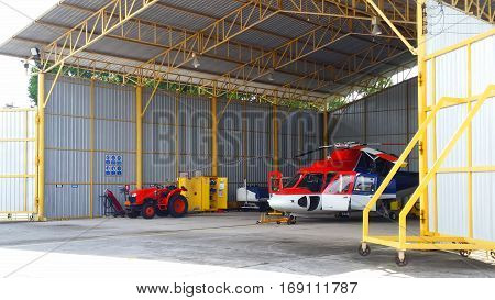 Helicopter of oil and gas industry parked in the hangar.Parking of helicopters at the airport.